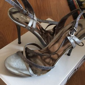 Silver heels with straps.